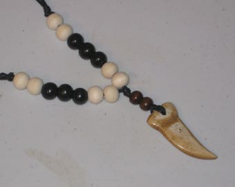 Hand carved prehistoric buffalo bone tooth, adjustable necklace.