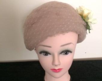 Beige/Brown Wedding Hat with Yellow flower detail.