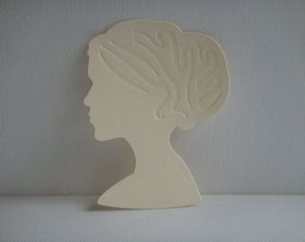 Cutout female figure in beige for scrapbooking or card drawing paper
