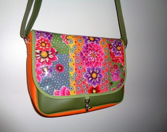 Faux leather Messenger bag khaki green and orange colored fabric coated on the flap.