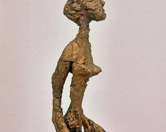 Golden aluminum sculpture. .. Giacometti style