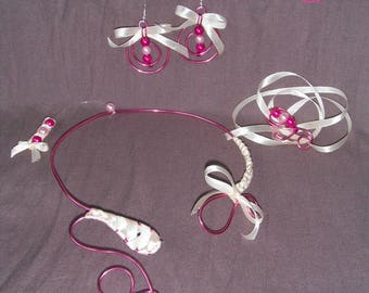 set in aluminum wire and satin ribbon