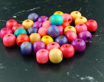 20 wooden 10 X 9 mm 011 round beads