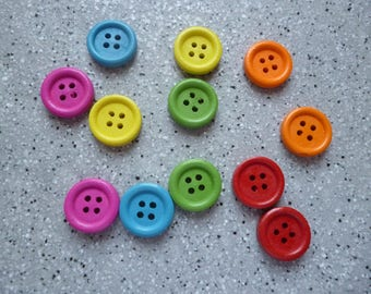 12 colored plastic, 4 hole round buttons