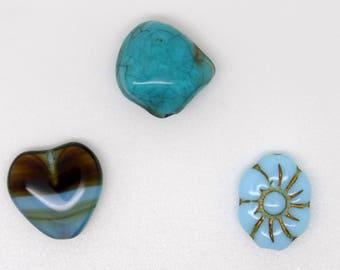 Glass heart, turquoise flower bead