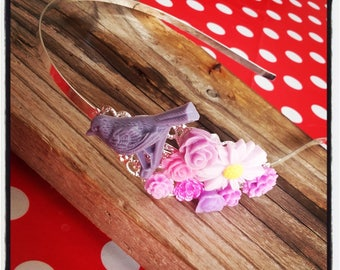Headband with design in silver and purple colored flowers