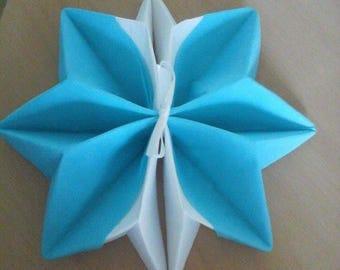 Snowflake napkin folding turquoise blue and white