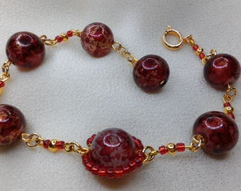 Bracelet round synthetic dark red gold