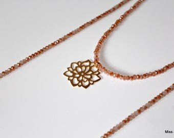 Orange long necklace in salmon pink glass beads