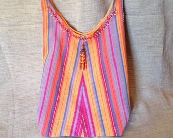 Bohemian bag striped fuchsia and orange fringe and tassel beads.