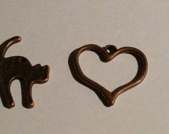2 bronze charms, a heart and a cat