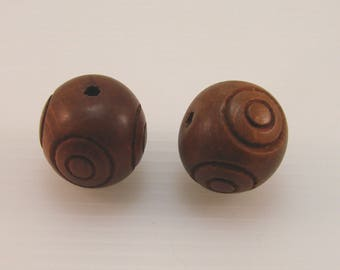 Set of 2 wooden carved 22.5 mm round beads.