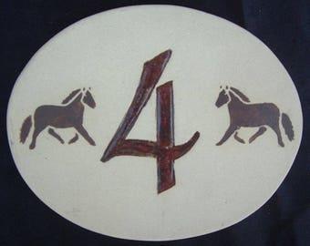 Oval '4' door number, horses