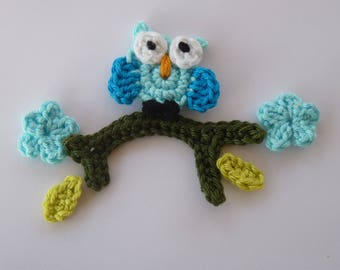 little turquoise OWL sitting on a branch - applique crochet