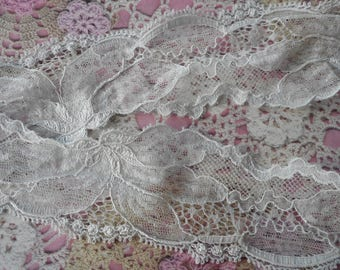 Finely perforated elastic grey lace polyester 4,50 cm width