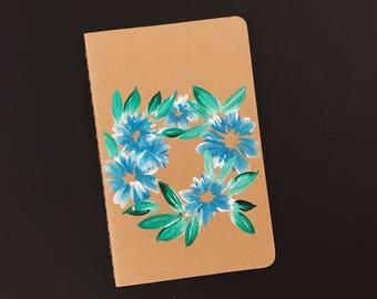 Blue flowers on small moleskine journal