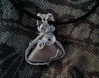Silver Agatized petrified wood pendant.
