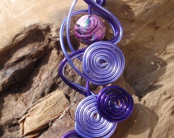 Very original this deep purple and light purple bi color pendant and bead marbled multi reflection