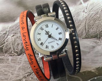 Ladies size watch. M round silver black and orange Have a lovely day