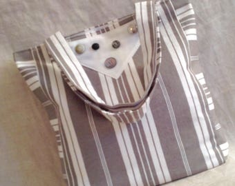 Bag ticking white bib with buttons.