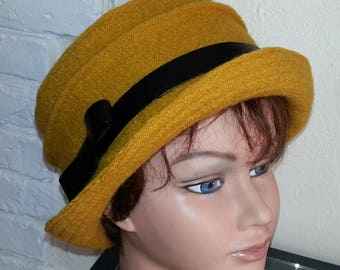 "Trendy ""mustard"" boiled wool hat."