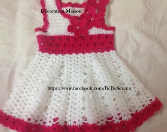 Cute white and pink crocheted baby dresses
