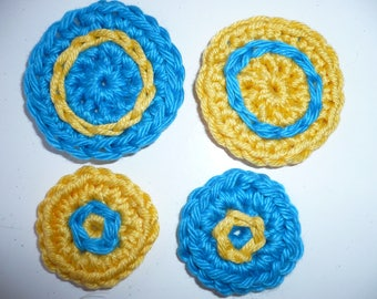 set of four round crocheted, multicolored, sewing or craft.