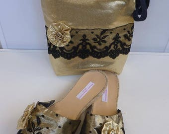 Black and gold evening bag matches the mules shoes