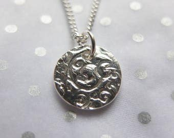 Decorative disc pendant