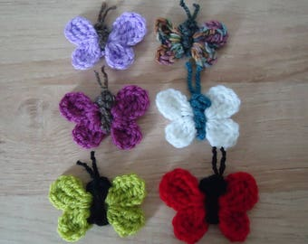 Six butterflies crocheted in different colors