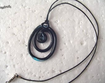 """Spiral"" collection ""celestial"" black and blue pendant with silver"