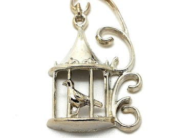 With silver metal bird cage charm