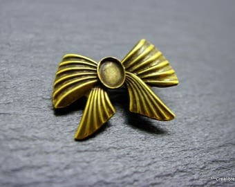 bronze art deco brooch