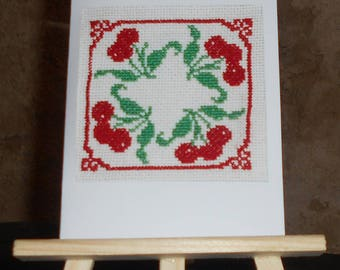 Card embroidered on canvas with cherries