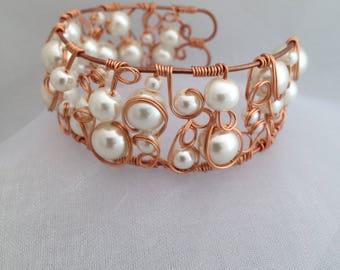 Copper and pearl cuff.