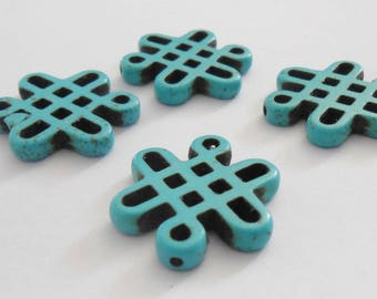 Turquoise Howlite beads shape 28 x 24 mm Chinese knots