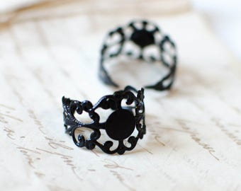 X 2 BLACK METAL FILIGREE BRASS RING SUPPORTS A SIFTER
