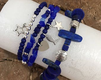 Trio of blue and silver bracelets, glass and silver beads and silver pendants