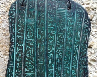 Clay tablet engraved signs symbols