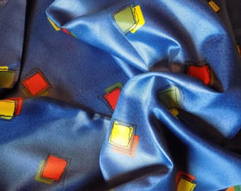 Blue/red/yellow/green silk effect fabric.