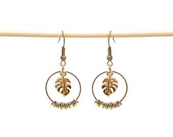 Earrings bronze rings and Golden monstera leaves