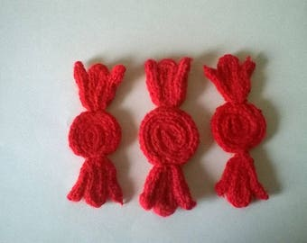 Candy red, wool, made by knitting.