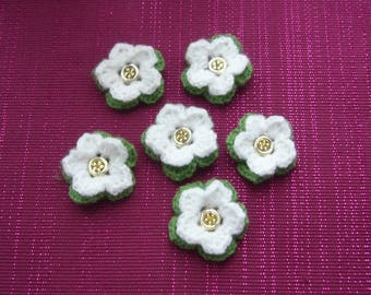 6 flowers are hand crochet white wool and green - yellow heart