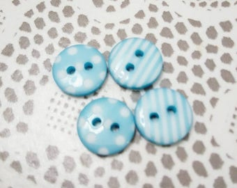 Set of 4 small round plastic buttons, blue patterned