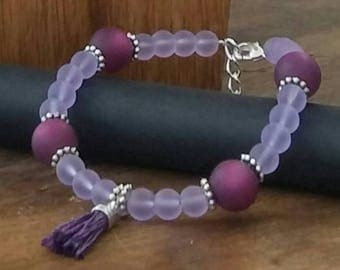 Bracelet purple / violet and tassel
