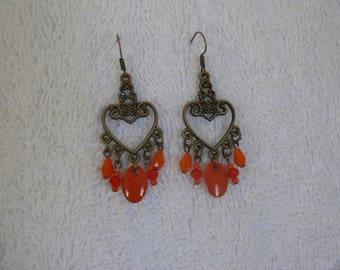 Single earring with and orange beads
