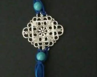Blue hemp bracelet with Medallion and shades of blue beads. Toggle closure. 9 1/2""