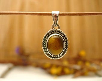 Sterling Silver and Tiger's eye.