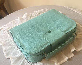 Small vintage traveling vanity suitcase