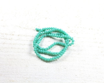35 abacus faceted blue - green glass beads approximately 3 to 4mm x 2.5 to 3mm